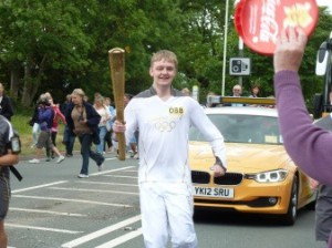 Callum with the Olympic torch